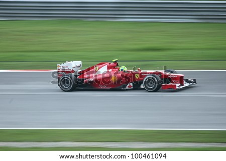 SEPANG,MALAYSIA-MARCH 25:Panning shot of Felipe Massa from Scuderia Ferrari    during the race day of Formula One PETRONAS Malaysian Grand Prix at Sepang F1 Circuit on March 25,2012 in Sepang,Malaysia - stock photo