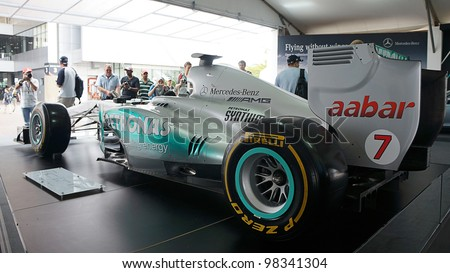 SEPANG, MALAYSIA-MARCH 23 : Rear view of Petronas Mercedes GP F1 car on display during the Malaysian F1 Grand Prix on March 23, 2012 in Sepang International Circuit in Sepang, Malaysia. - stock photo