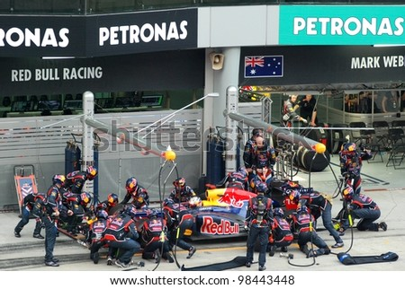 SEPANG, MALAYSIA - MARCH 25: Redbull Racing Team crews does pit-stop practice at the 2012 F1 Petronas Malaysian Grand Prix at Sepang International Circuit on March 25, 2012 in Sepang, Malaysia - stock photo