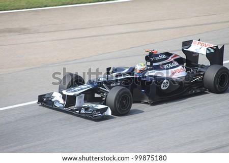 SEPANG, MALAYSIA - MARCH 23: Venezuelan Pastor Maldonado of Williams-Renault in action during Friday practice at Petronas Formula 1 Grand Prix on March 23, 2012 in Sepang, Malaysia - stock photo