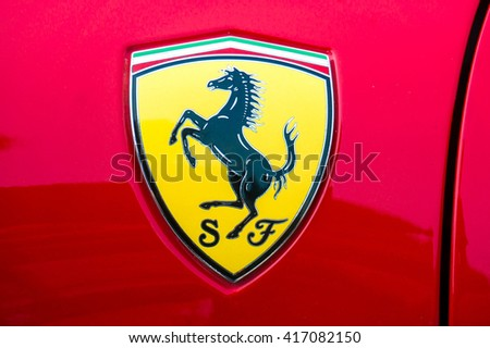 SEPANG, MALAYSIA - MAY 8, 2016: Ferrari logo. Ferrari is an Italian sports car manufacturer based in Maranello. Founded by Enzo Ferrari in 1939. - stock photo