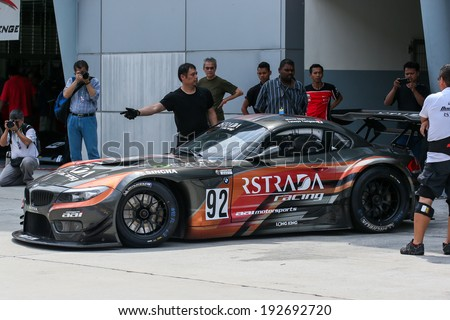 SEPANG, MALAYSIA - MAY 10, 2014: The BMW car of Morris Chen and Tatsuya Tanigawa leaves to start the free practice session of the Malaysian Super Series Round 2 in Sepang International Circuit. - stock photo