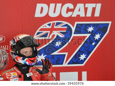 SEPANG, MALAYSIA - OCT 23 : Australian Casey Stoner of Ducati Marlboro Team gestures after a testing session at Shell Advance Malaysian Motorcycle Grand Prix held October 23, 2009 in Sepang, Malaysia.