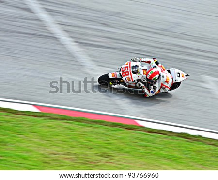 SEPANG, MALAYSIA - OCTOBER 21: Marco Simoncelli from San Carlo Honda Gresini Team in action during MotoGP Test Day at Sepang International Circuit on October 21, 2011 in Sepang, Malaysia. - stock photo