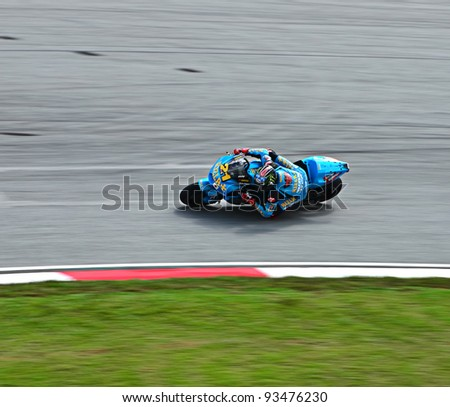 SEPANG, MALAYSIA - OCTOBER 21: Moto GP Rider John Hopkins from of Rizla Suzuki MotoGP Team in action during MotoGP Test Day at Sepang International Circuit on October 21, 2011 in Sepang, Malaysia. - stock photo