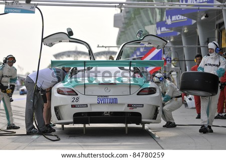 SEPANG, MALAYSIA-SEPT 16:PETRONAS Syntium Team driver in Mercedes SLS car at pitstop during GT Class qualifying session of Malaysia Merdeka Endurance Race (MMER) 2011 in Sepang, Malaysia on 16, 2011