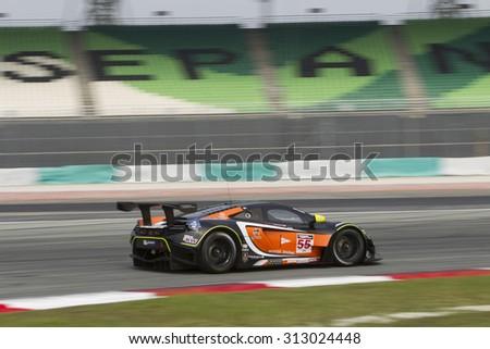 Sepang, Malaysia - September 4, 2015 : British McLaren car no 55 enters turn 1 at Asian Festival of Speed Race, Sepang, Malaysia  - stock photo