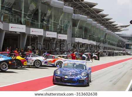 Sepang, Malaysia - September 5, 2015 : Chinese Li Chao of Team Betterlife exits pitlane at Porsche Carrera Cup Asia AFOS, Sepang, Malaysia  - stock photo