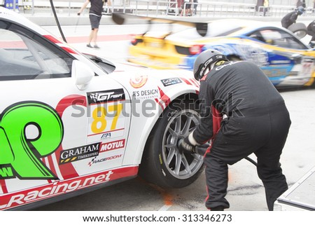 Sepang, Malaysia - September 5, 2015 : German Porsche Car No 87 pits for tires at Asian Festival of Speed Race, Sepang, Malaysia