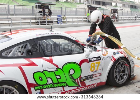 Sepang, Malaysia - September 5, 2015 : German Porsche Car No 87 refuels at Asian Festival of Speed Race, Sepang, Malaysia  - stock photo