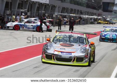 Sepang, Malaysia - September 4, 2015 : Team Clearwater Racing car 12 exits pitlane at Porsche Carrera Cup Asia AFOS, Sepang, Malaysia  - stock photo
