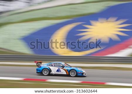 Sepang, Malaysia - September 4, 2015 : Team Racing Spirit Thailand car 80 enters turn 3 at Porsche Carrera Cup Asia AFOS, Sepang, Malaysia  - stock photo