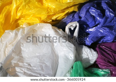 Separated colorful used plastic shopping  bags for waste collection - stock photo