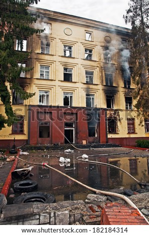 separatists burned the headquarters of a military unit - stock photo