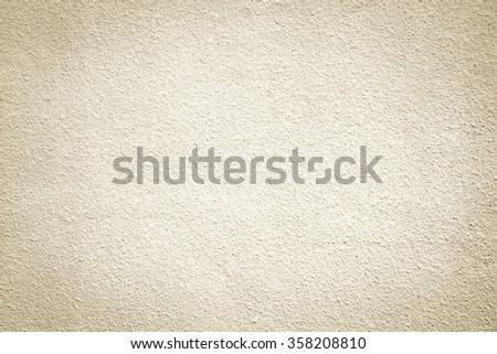 sepia beige warm tone colored cement wallpaper background textured:cream color pure cement wall for home interior,design,decorate:clean stucco backdrop interior.rough and vignette wallpaper concept. - stock photo