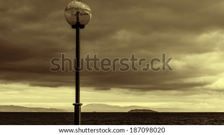 Sepia Black sea at stormy seaside - stock photo