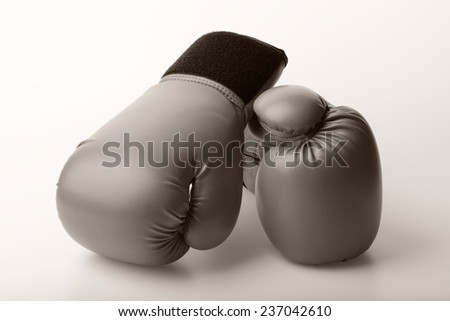 sepia color pair of leather boxing gloves - stock photo