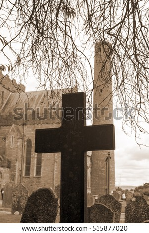 sepia cross at ancient graveyard in St Caniceâ??s Cathedral in kilkenny city ireland