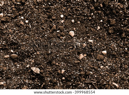 Sepia effect natural organic soil texture. Soil organic matter background with sand, road-metal and chippings. - stock photo