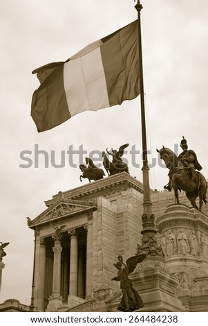 Sepia image of Italian flag flying over the Monument to King Victor Emmanuel II, Rome, Italy, Europe - stock photo