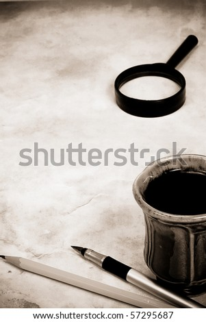 sepia image of school accessory at paper - stock photo