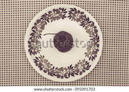 sepia kiwi fruit on a floral plate
