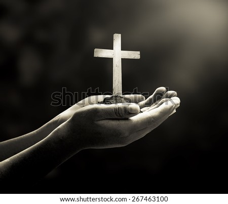 Sepia tone. Human hands holding the wooden white cross. Thanksgiving Background, Christmas, Worship, Forgiveness, Mercy, Repentance, Adoration, Glorify concept.