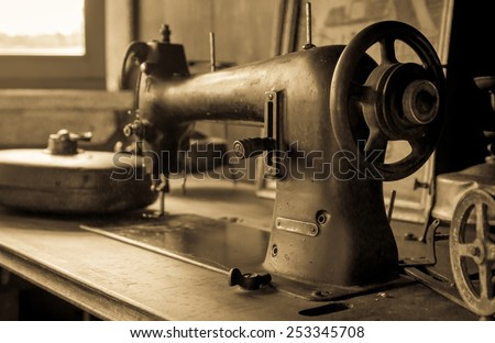 Sepia tone photo of vintage german sewing machine - stock photo