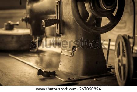 Sepia tone photo of vintage german sewing machine - stock photo