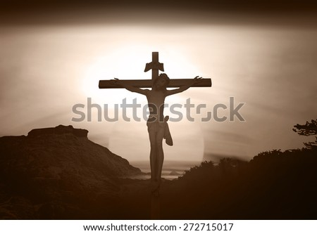 Sepia tone. Silhouette Jesus on the cross over blurred sunset background.