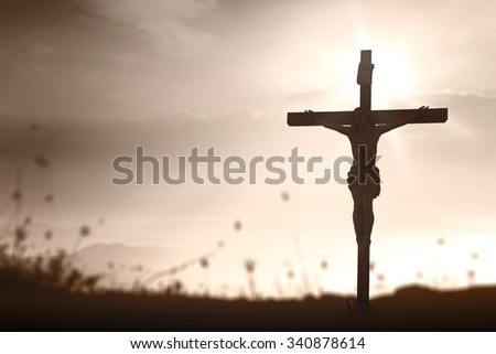Sepia tone. Silhouette Jesus with cross on blurred beautiful autumn sunset with amazing light background. Thanksgiving, Christmas, Worship, Forgiveness, Mercy, Repentance, Adoration, Glorify concept. - stock photo