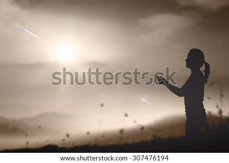 Sepia tone. Silhouette of woman praying over beautiful sunset with amazing golden light background. International Day of the Girl Child concept. World Mental Health Day concept. - stock photo