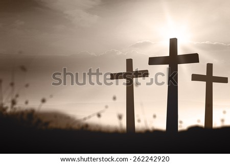 Sepia tone. Silhouette three crosses over blurred sunset background. - stock photo