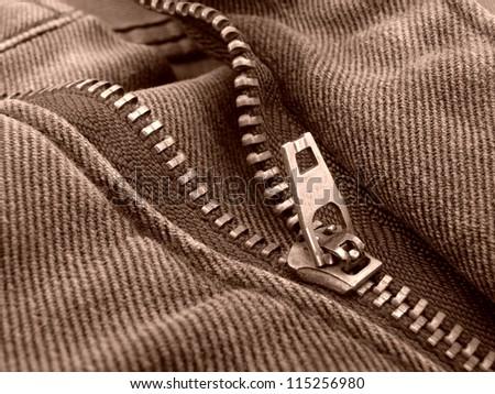 sepia toned denim fragment with zipper - stock photo