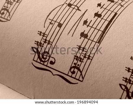 sepia toned fragment of sheets of musical notes - stock photo