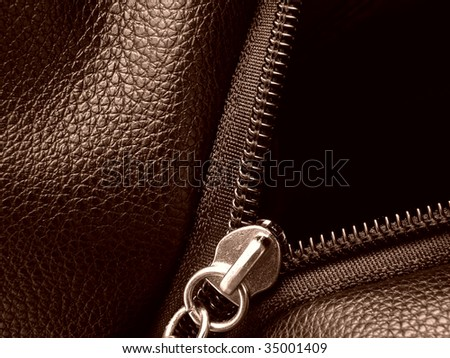 sepia toned leather swatch with metal zipper closeup fragment - stock photo