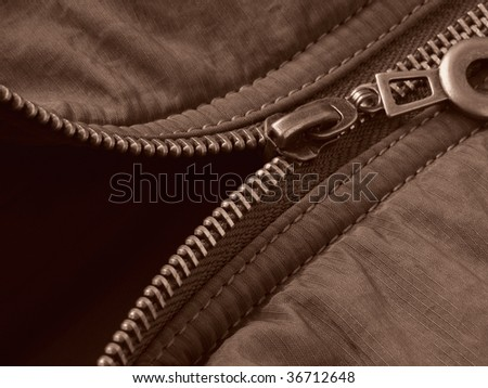 sepia toned modern jacket fragment with metal zipper - stock photo