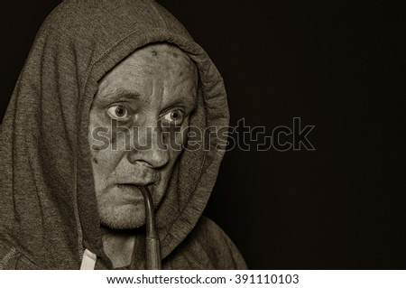 Sepia toned portrait of mature man meditating in darkness
