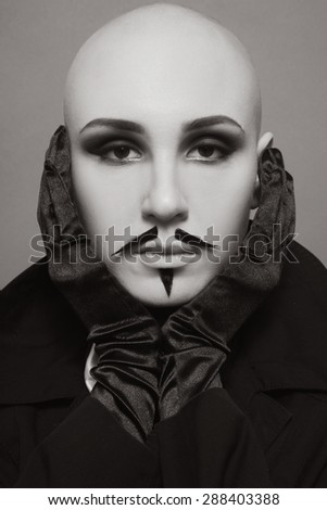 Sepia vintage portrait of skinhead woman with false whiskers and imperial beard - stock photo