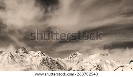 Sepia winter mountains in fog. Panorama Caucasus Mountains, Georgia. Ski resort, Gudauri. - stock photo