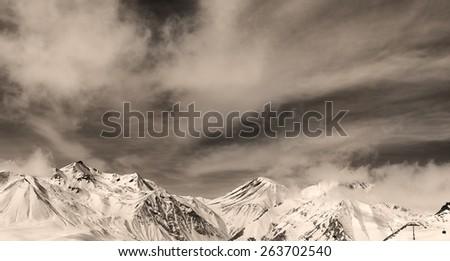 Sepia winter mountains in fog. Panorama Caucasus Mountains, Georgia. Ski resort, Gudauri. - stock photo
