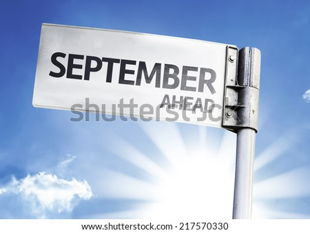 September Ahead written on the road sign