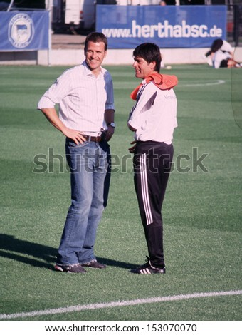 SEPTEMBER 5, 2004 - BERLIN: Oliver Bierhoff and Joachim Loew at a training session of the German national soccer team in Berlin. - stock photo