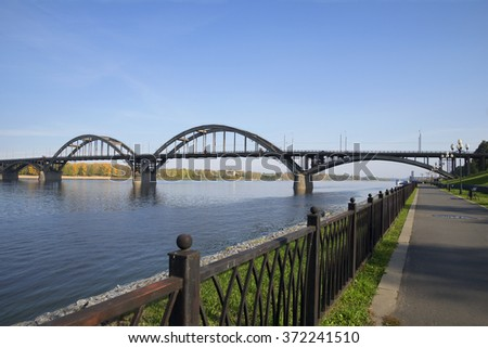 September day on the Volga embankment. Views of the road bridge across the Volga river. Rybinsk, Russia