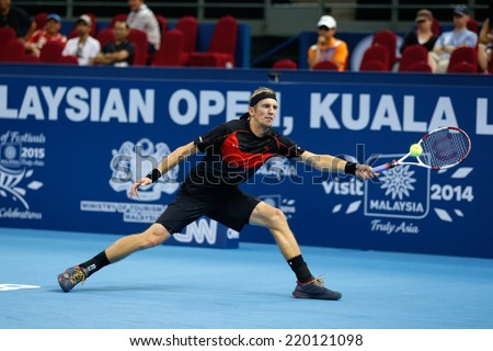 SEPTEMBER 23, 2014 - KUALA LUMPUR, MALAYSIA: Jarkko Nieminen of Finland makes a forehand return in his first round match at the Malaysian Open Tennis 2014 event. This is an ATP sanctioned tournament. - stock photo