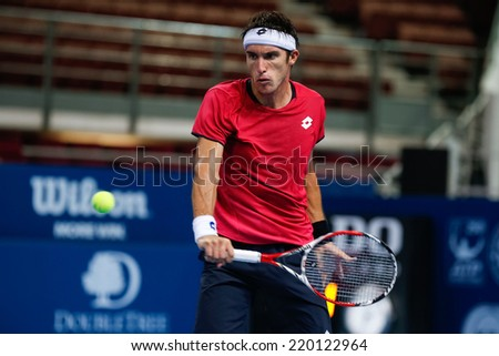 SEPTEMBER 25, 2014 - KUALA LUMPUR, MALAYSIA: Leonardo Mayer of Argentina makes a backhand return in his match at the Malaysian Open Tennis 2014. This is an ATP sanctioned tournament. - stock photo