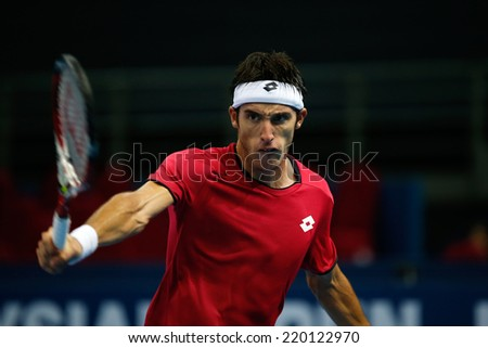 SEPTEMBER 25, 2014 - KUALA LUMPUR, MALAYSIA: Leonardo Mayer of Argentina reacts after making a backhand return in his match at the Malaysian Open Tennis 2014. This is an ATP sanctioned tournament. - stock photo