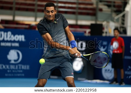 SEPTEMBER 23, 2014 - KUALA LUMPUR, MALAYSIA: Nick Kyrgios of Australia makes a backhand return in his first round match at the Malaysian Open Tennis 2014. This is an ATP sanctioned tournament. - stock photo