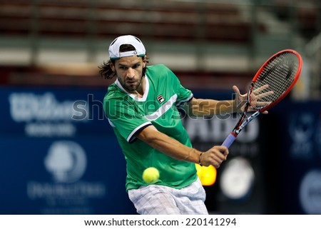 SEPTEMBER 25, 2014 - KUALA LUMPUR, MALAYSIA: Philipp Petzchner of Germany makes a backhand return in his match at the Malaysian Open Tennis 2014. This is an ATP sanctioned tournament. - stock photo