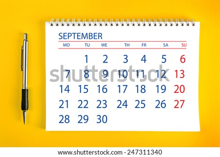September Paper Calendar Page with Spiral Binding as Time Management and Schedule Concept, top view - stock photo